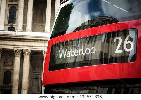 Detail of a red London bus on route to Waterloo.