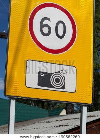 Road speed limit sign. Photographing a violation