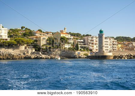 CASSIS,FRANCE-AUGUST 10,2016:The port of Cassis a French village with colorful boats moored and the lighthouse during a summer day.