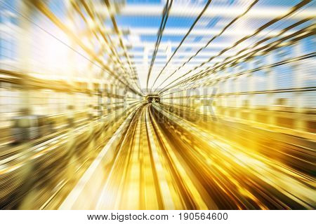 Motion blur of a Japanese tunnel monorail train with sunset light. Tokyo, Japan. Concept of transport, speed, futuristic city and modernity.