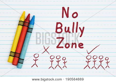 No Bully Zone hand lettering text on retro lined paper and three crayons