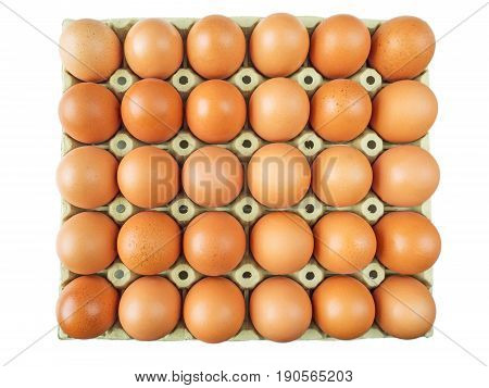 Cardboard box of brown chicken eggs top view isolated on white