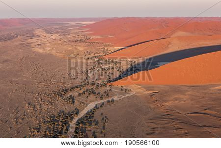 View from a Helicopter of the large red sand dunes in the Namib Naukluft Park Sossusvlei Namibia