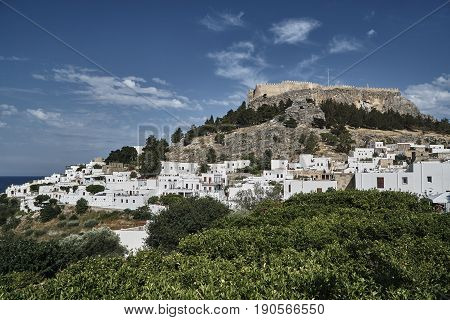 Medieval fortress and white houses of Lindos village in Rhodes