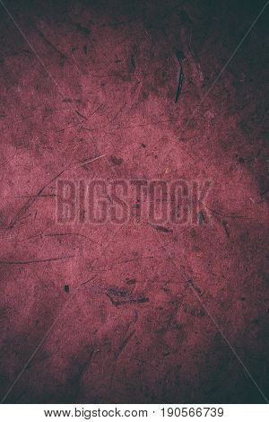Red grunge texture. Abstract texture and background for designers. Vintage paper background. Rough red texture of recycled paper. Closeup view of abstract red texture. Vintage red paper.