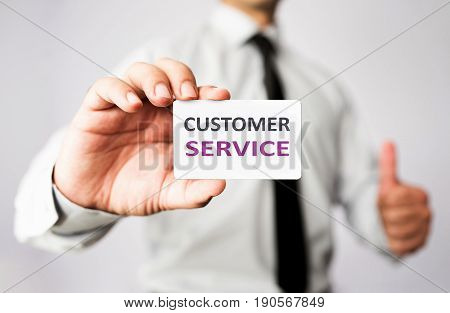 Businessman Is Showing His Customer Service Vcard