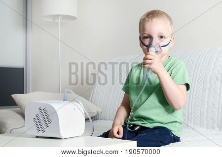 Boy Making Inhalation With Nebulizer At Home