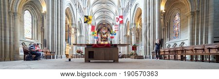 Lausanne, Switzerland. 4th June 2017. An interior view of the Cathedral in Lausanne. Some tourists and worshipers are walking around the building.