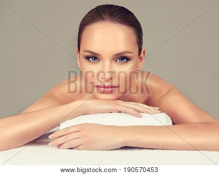Massage and body ody care. Spa body massage treatment. Woman having massage in the spa salon for beautiful girl