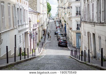 Paris, France - May 12, 2017: People in a street in Montmartre district