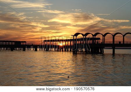 Fishing pier at sunset at Jekyll Island, Georgia.