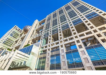 Tokyo, Japan - April 19, 2017: bottom view of Fuji Television Building and Observatory in Odaiba island, Minato district. Fuji TV headquarters is known for its bizarre architecture by Kenzo Tange.