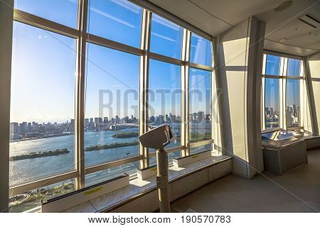 Tokyo, Japan - April 19, 2017: tourist binocular at free viewing of Rainbow Bridge and Tokyo Skyline from Fuji Television Observatory in Odaiba island. Observatory deck interior.