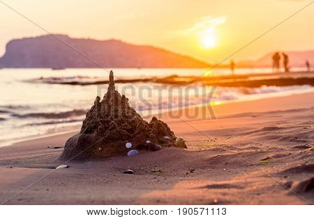 Ruined sandcastle on the beach at sunset in Alanya, Turkey