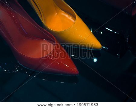 Red And Yellow Shiny Shoes, Patent Leather On A Dark Background Stylish