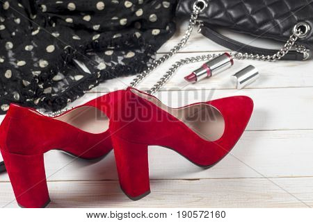 Women Clothing Set And Accessories On White Wooden Background.