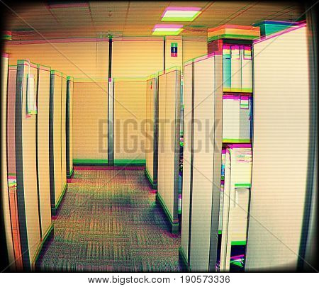 A video camera view inside of a cubicle office.