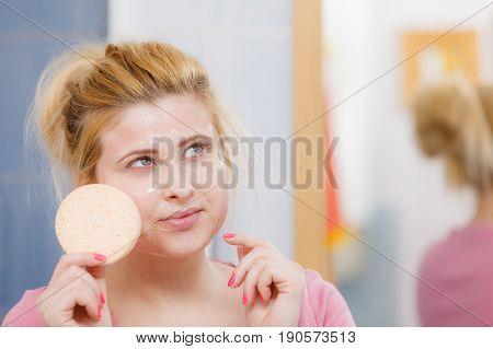 Woman Having Wash Gel On Face Holding Sponge