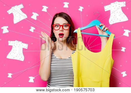 Young Woman With Dress On Hanger