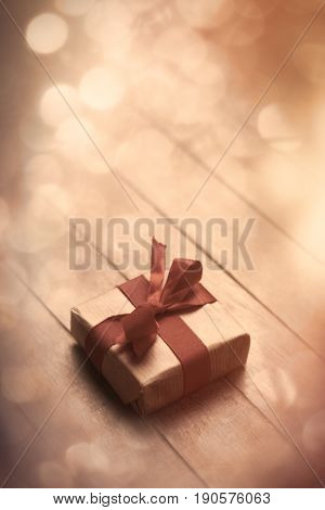 Beautiful Small Gift Lying On The Wonderful Wooden Brown Background