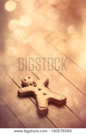 Cute Gingerbread Man Lying On The Wonderful Brown Wooden Background