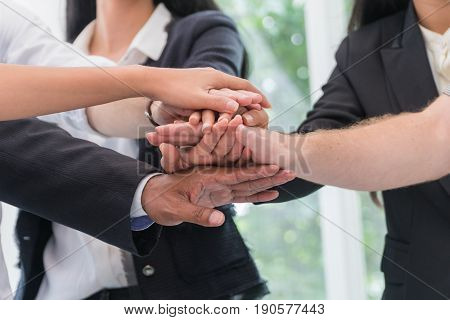 Hands of a businessman joining hands to work together. Teamwork Concept.