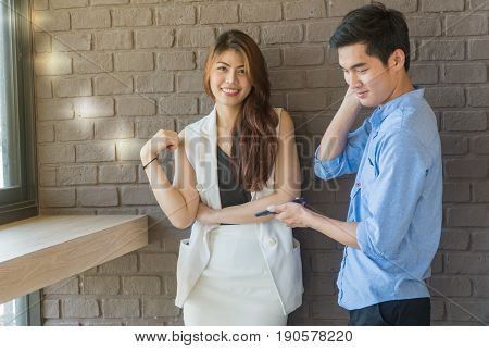 The young man asks for a beautiful girl phone number in a coffee shop.