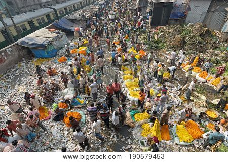 KOLKATA WEST BENGAL / INDIA - FEBRUARY 13TH : Over view of Busy crowded and colorful Mallik Ghat or Jagannath ghat flower market in Kolkata on 13.02.16. One of Biggest flower markets in Asia.