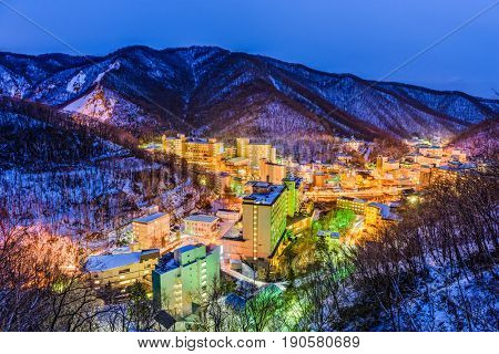 Noboribetsu, Japan hot springs town winter skyline.