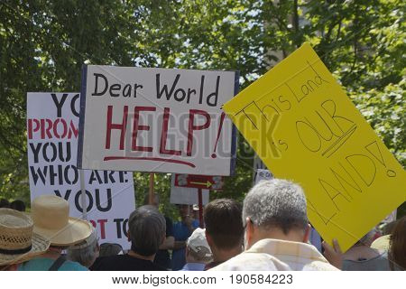 Asheville, North Carolina, USA - June 3, 2017: Close up of a crowd of American political protesters at a