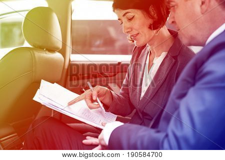 Business people meeting and discussion on backseat of the car