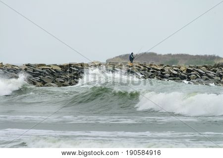 Westport Massachusetts USA - May 19 2007: Fisherman on Gooseberry Neck causeway in Westport Massachusetts