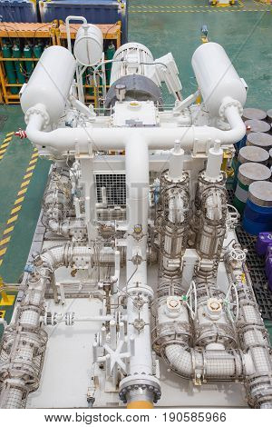 Gas booster compressor in vapor recovery unit for recovery heavy hydrocarbon lost in light end gases at oil and gas central processing platform