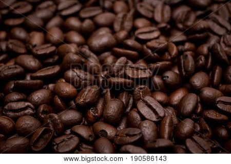 Organic coffee beans in background close up.