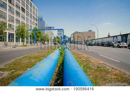 Berlin Germany - May 19 2017: Blue pipes at the street of Berlin city. The pipes are used to pump water away from construction sites due to the city's high groundwater level.