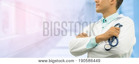 Male Doctor On Hospital Background