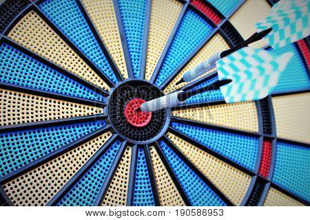 An image of a dartboard - target, darts