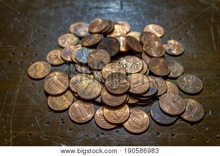 Pile of pennies laying on the table poster
