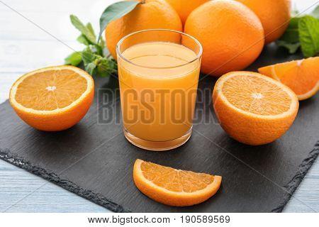 Orange juice with fresh fruit on slate plate