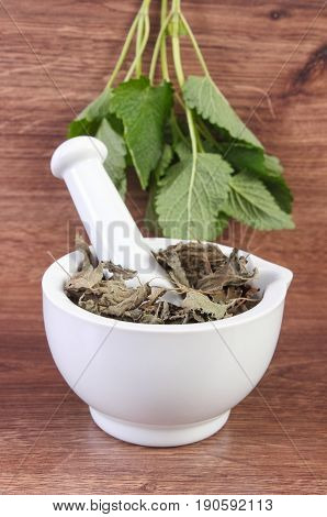 Fresh Green And Dried Lemon Balm In Mortar, Concept Of Herbalism And Alternative Medicine