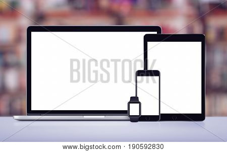 Laptop, tablet pc, smartphone and smartwatch responsive design mockup on office desk.
