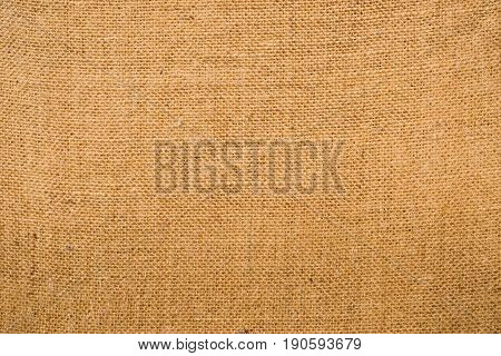 Piece of hessian fabric showing the woven pattern and texture