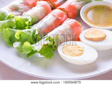 Fresh vegetable salad roll with boiled egg Health care concept.