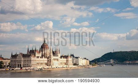 A cityscape of Budapest with the Hungarian Parliament building in the foreground and the chain bridge over the Danube in the background Hungary