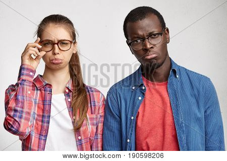 People, Lifestyle And Relationships. Mixed Race Couple Feeling Unhappy And Disappointed While Squabb
