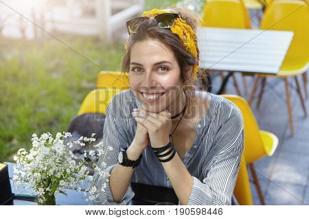 Outdoor Portrait Of Pretty Woman With Dark Charming Eyes Wearing Sunglasses And Scarf On Head Dresse
