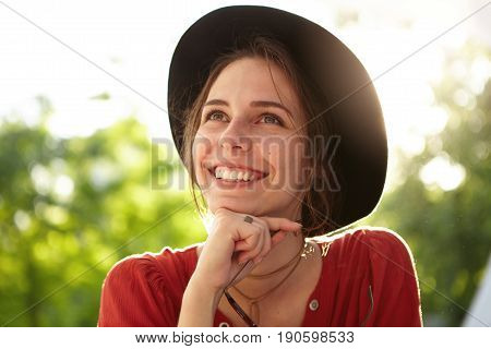 Outdoor Portrait Of Young Romantic Woman With Gentle Eyes And Tender Smile With White Even Teeth Wea