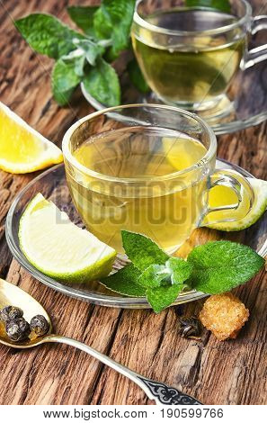 Herbs Tea With Lime And Mint Leaves