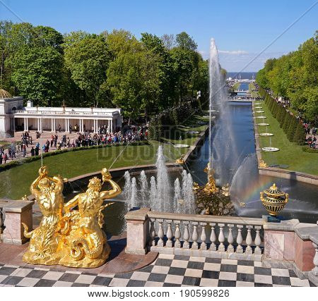 Petergof, Russia - June 5, 2017: The Grand Cascade and Samson Fountain at the Grand Peterhof Palace. These palaces and gardens are sometimes referred as the -Russian Versailles-. Background: The Sea Canal.