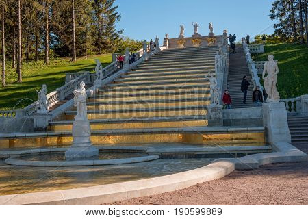 Petergof, Russia - June 5, 2017: Cascade of the Golden Mountain. The prototype for it was one of the cascades of the French royal residence, Marley le Roy. Decorated with sculptures of Greek gods.